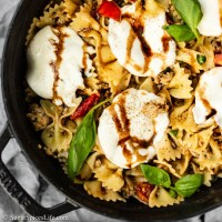 Ground chicken sautéd herbs and pesto, then tossed with tomatoes and basil in a brown butter sauce. This Tomato Basil Chicken Pasta is packed with flavor!