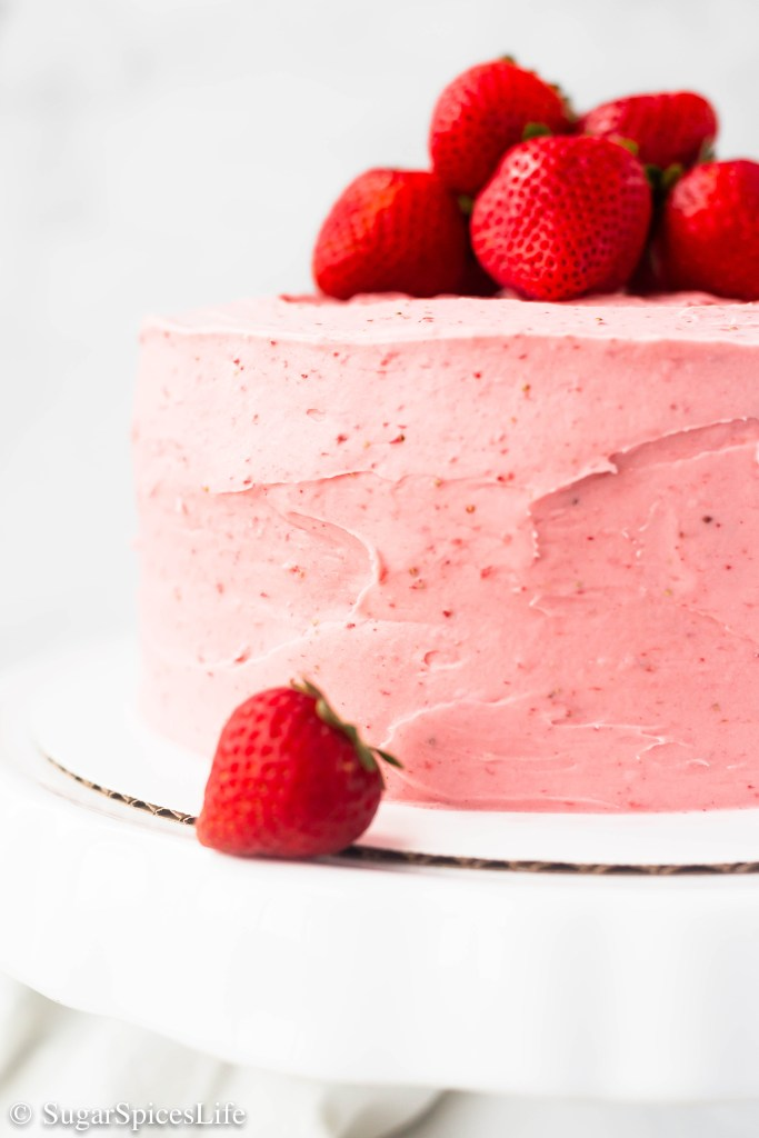 A rich, buttery cake with a hint of fresh strawberries, filled and finished with a cream cheese strawberry frosting. This Strawberry Cake with Strawberry Frosting is a decadent delight!