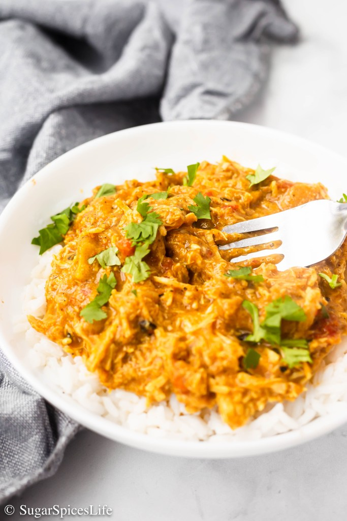 Curry chicken in a creamy, coconut milk sauce, served of rice. This Instant Pot Coconut Curry Chicken is a delicious and  filling, yet healthier, dinner.