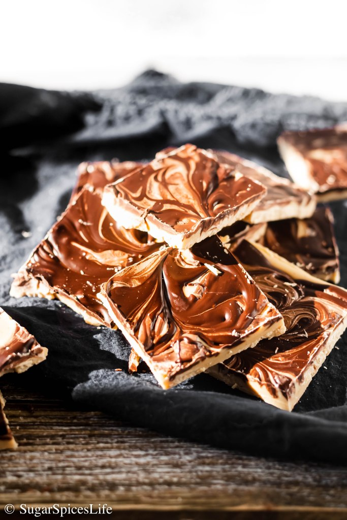 Melted white chocolate and peanut butter, swirled together with milk and dark chocolates to make a delicious candy treat. This Tiger Butter Fudge may be simple to make, but will be sure to impress!