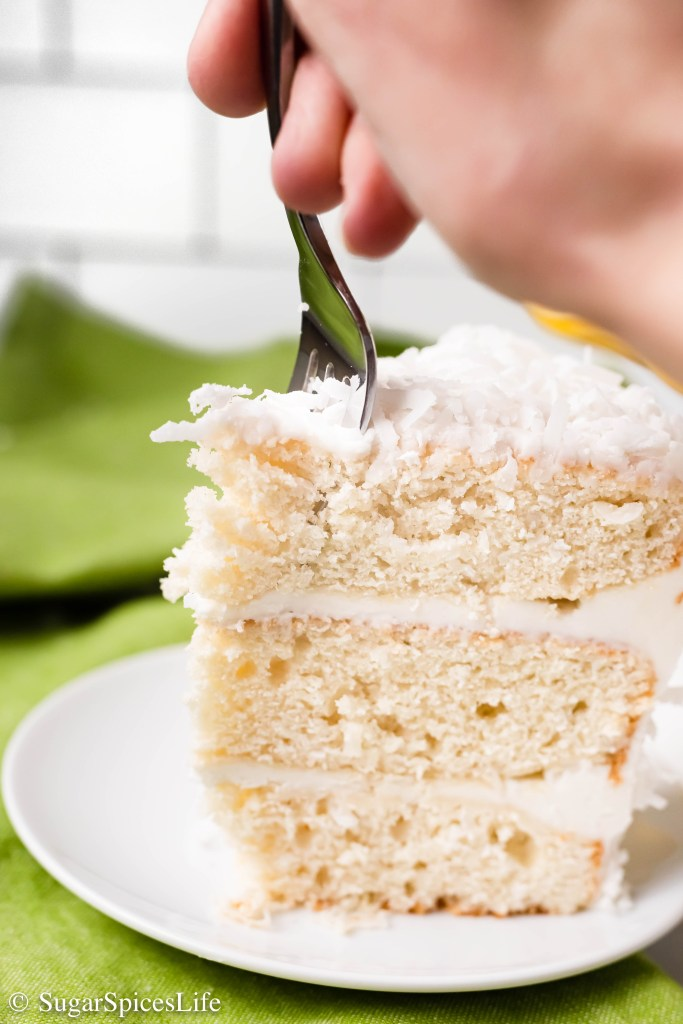 Soft, white cake frosted with a coconut buttercream, and filled with coconut in every delectable layer. This Coconut Cake is the stuff of coconut dreams!