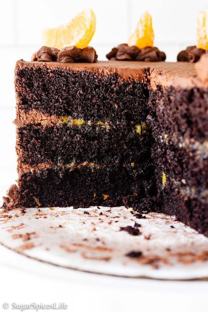 Fluffy, chocolate cake layers filled with orange curd and finished with an orange chocolate buttercream frosting. This Orange Chocolate Cake tastes like a candy chocolate orange turned into a cake!
