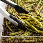 Green beans tossed with olive oil and delicious spices, then air fried to be perfectly crispy. These Air Fried Green Beans are an easy delicious vegetable dish!