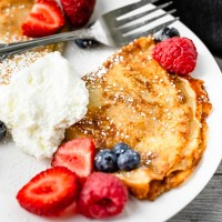Crepes filled with Dulce de Leche then caramelized to be perfectly crisp. These Caramelized Dulce de Leche Crepes will take your home dessert-game to the next level.