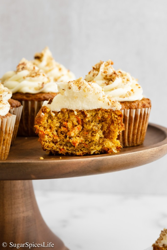 Soft cupcakes with pecans, coconut, carrots, and a hint of spice. Topped with a cream cheese frosting, these Carrot Cake Cupcakes are a perfect, individually sized dessert!