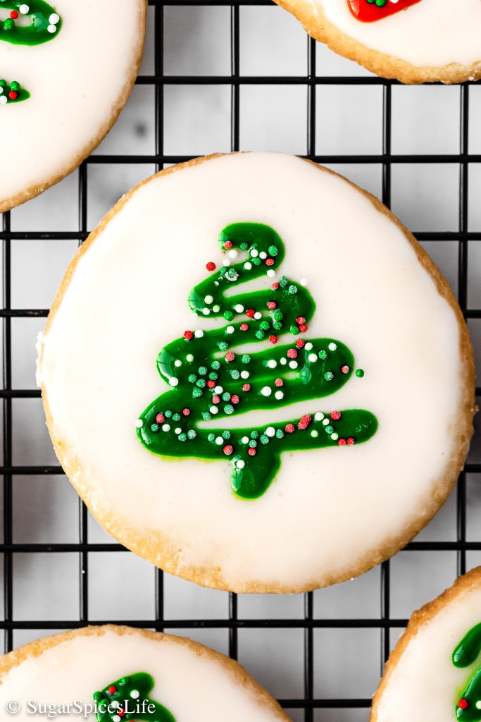 Crumbly yet soft shortbread cookies finished with a beautiful glaze. These Glazed Shortbread Cookies are as pretty as they are delicious!