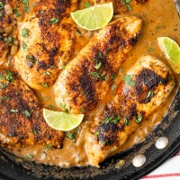 Chicken cooked in a creamy, cilantro lime sauce. Made with coconut milk, this Cilantro Lime Skillet Chicken has less dairy than most cream sauces, but has no shortage of flavor!