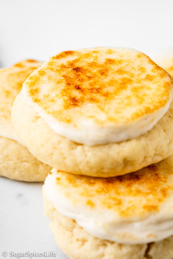 Soft, cake-like cookies with a cream cheese frosting and burnt sugar topping. These Crème Brûlée Cookies are a unique dessert that will have everyone asking for more!