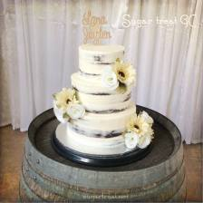 Semi naked chocolate cake with artificial flowers
