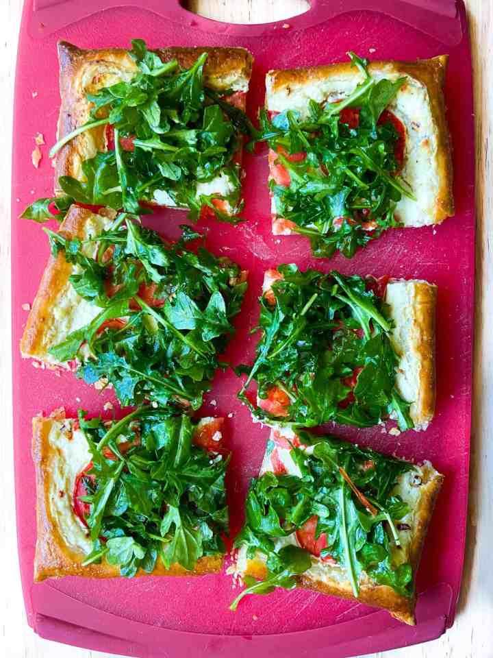 A sliced Tomato Ricotta Tart with Arugula