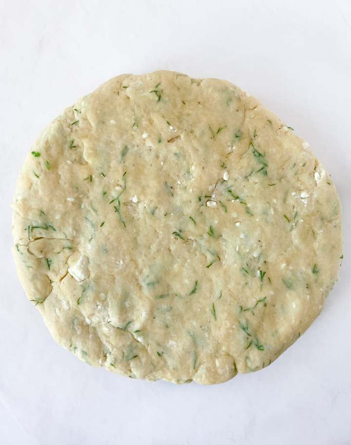 a disk of dill scone dough