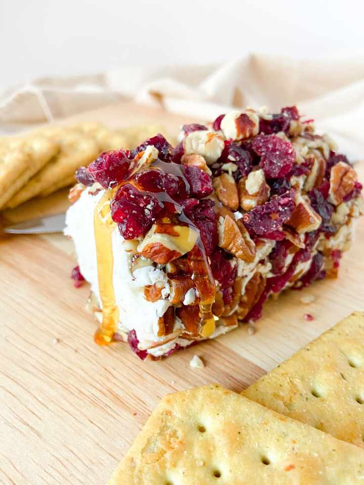 cranberry pecan goat cheese log with honey drizzle
