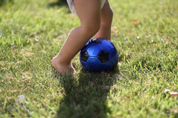 SugaShoc_Photography_Children_Photographer_Bucks County_Doylestown_PA_child_toddler_kicking_soccer_ball
