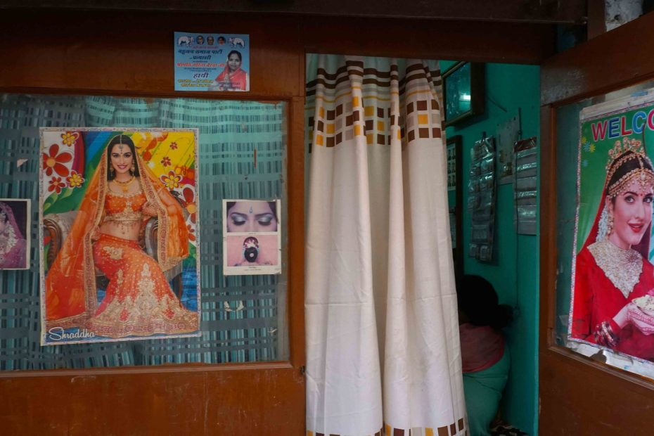 Posters of pretty women in Indian beauty shop