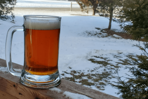 Glass of festbier outside in the snow