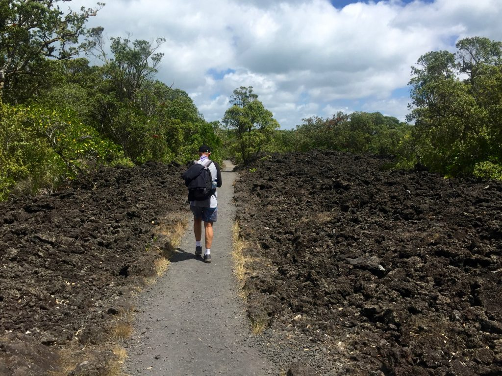 Walking through the volcanic rock on Rangitoto Island in Auckland.