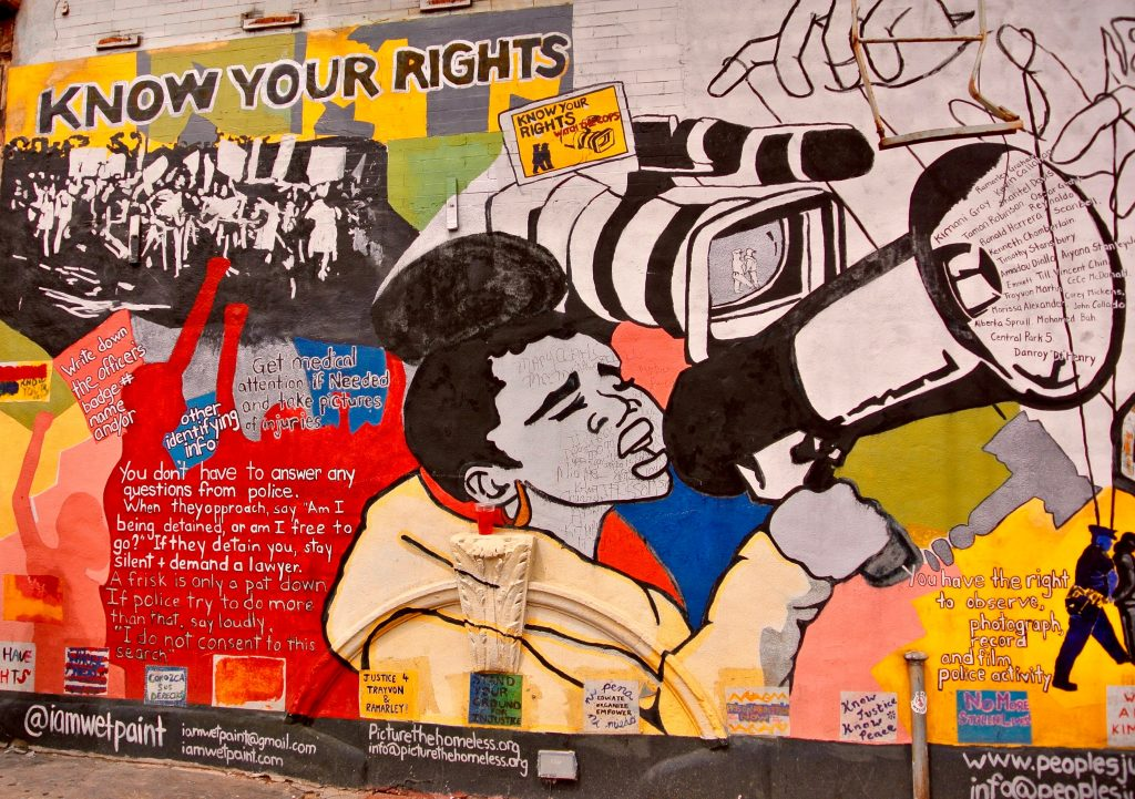 Know your rights mural on the streets of Harlem.