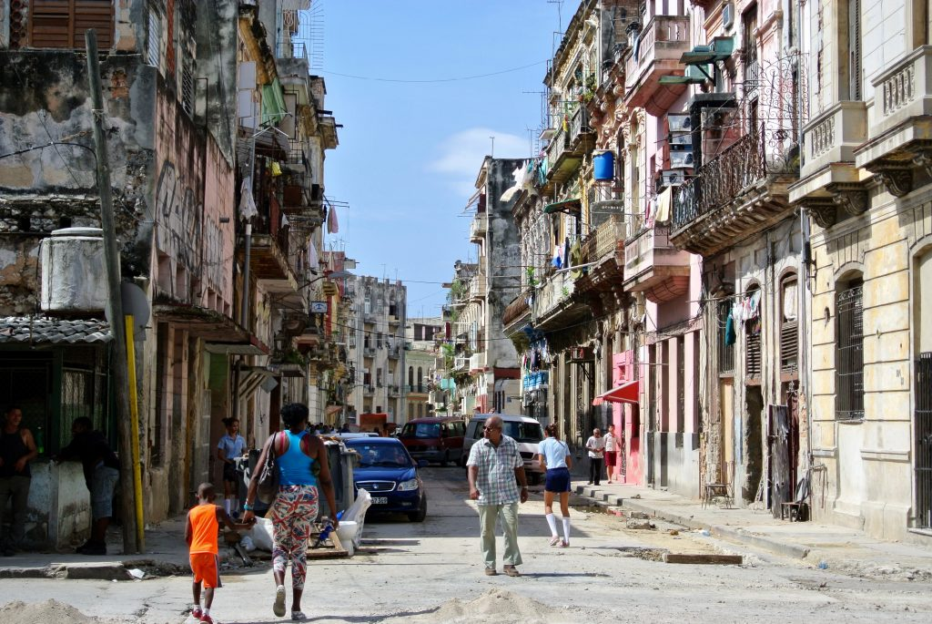 Dilapidated buildings in a busy street in Central Havana