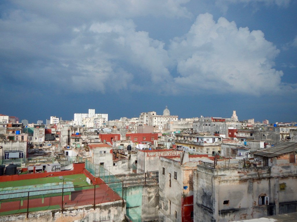View out over Havana from the rooftop bar at La Guarida on a stormy night.