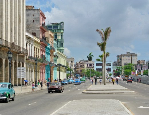Vintage cars and colourful buildings in Havana, Cuba.