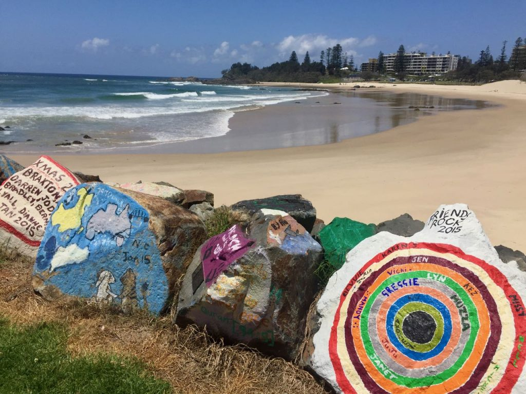 The breakwall at Port Macquarie is colourfully painted with messages of love.