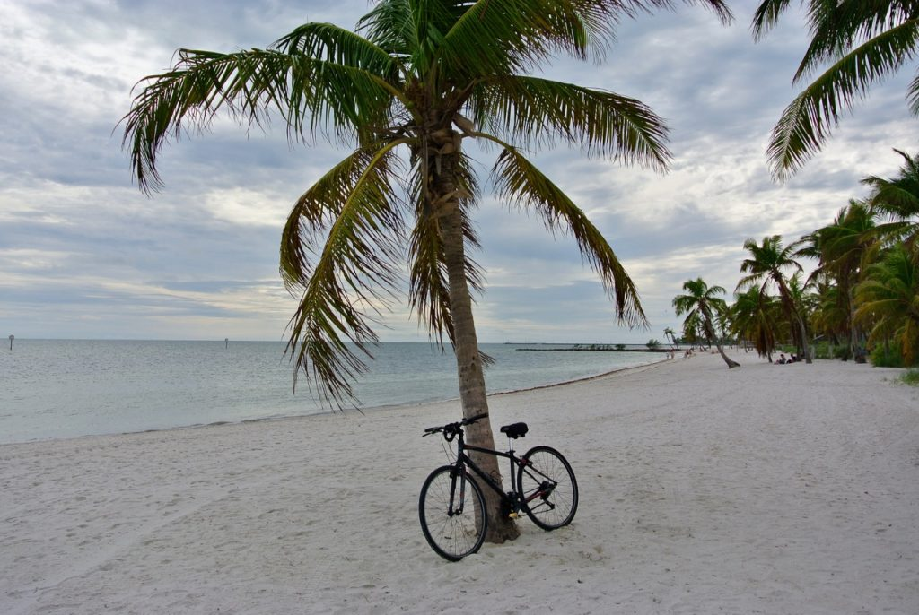 Taking a rest at Smathers Beach after cycling around the island.