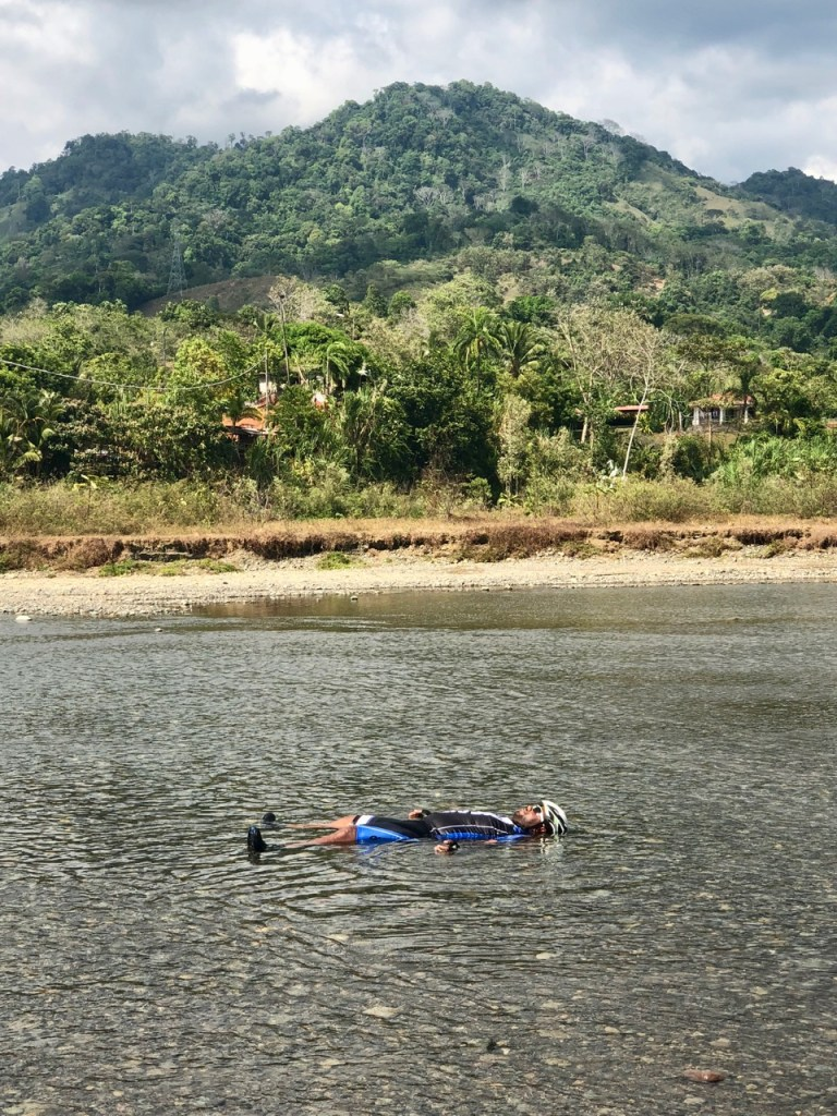 Our guide Mau threw himself into the river, bike helmet and all, to cool down from our hot ride.