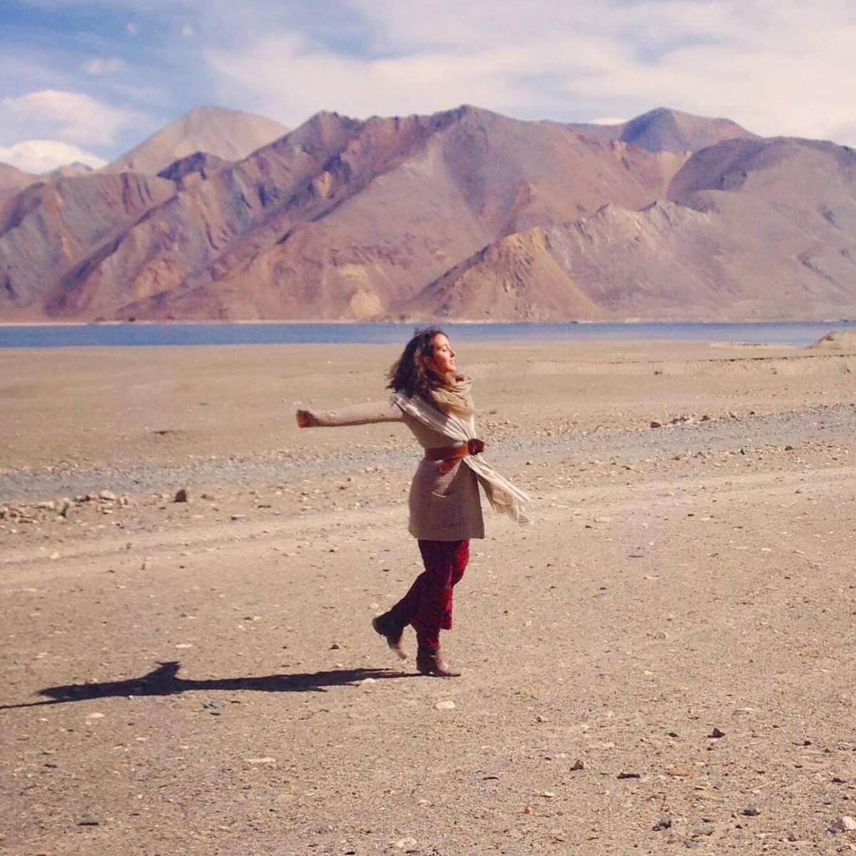 Carina jumping in the desert