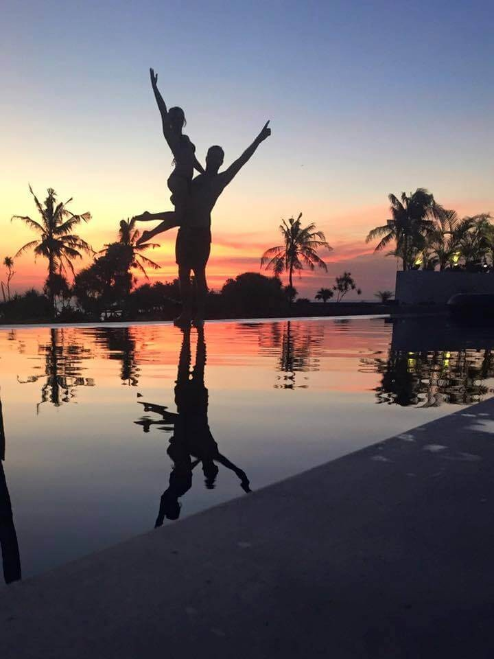 lindsey jumping by the pool at sunset