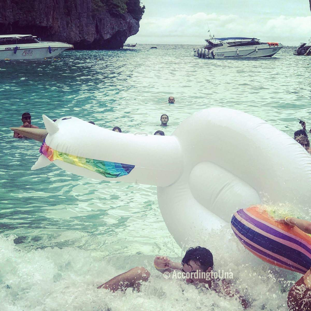 Una and a giant unicorn ocean floaty.