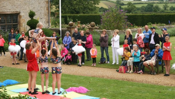 Cheerleaders perform on the front lawn