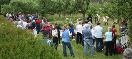 Spectators gather for the re-enactment of the French/English/Native American skirmish