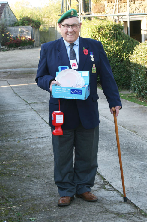 Ex-Serviceman Donald Taylor of Tow Rise selling poppies in the village