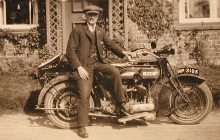 Wisteria Cottage owner Cecil Walton outside the house with his motor cycle and side-car in the late 1920s or early 1930s
