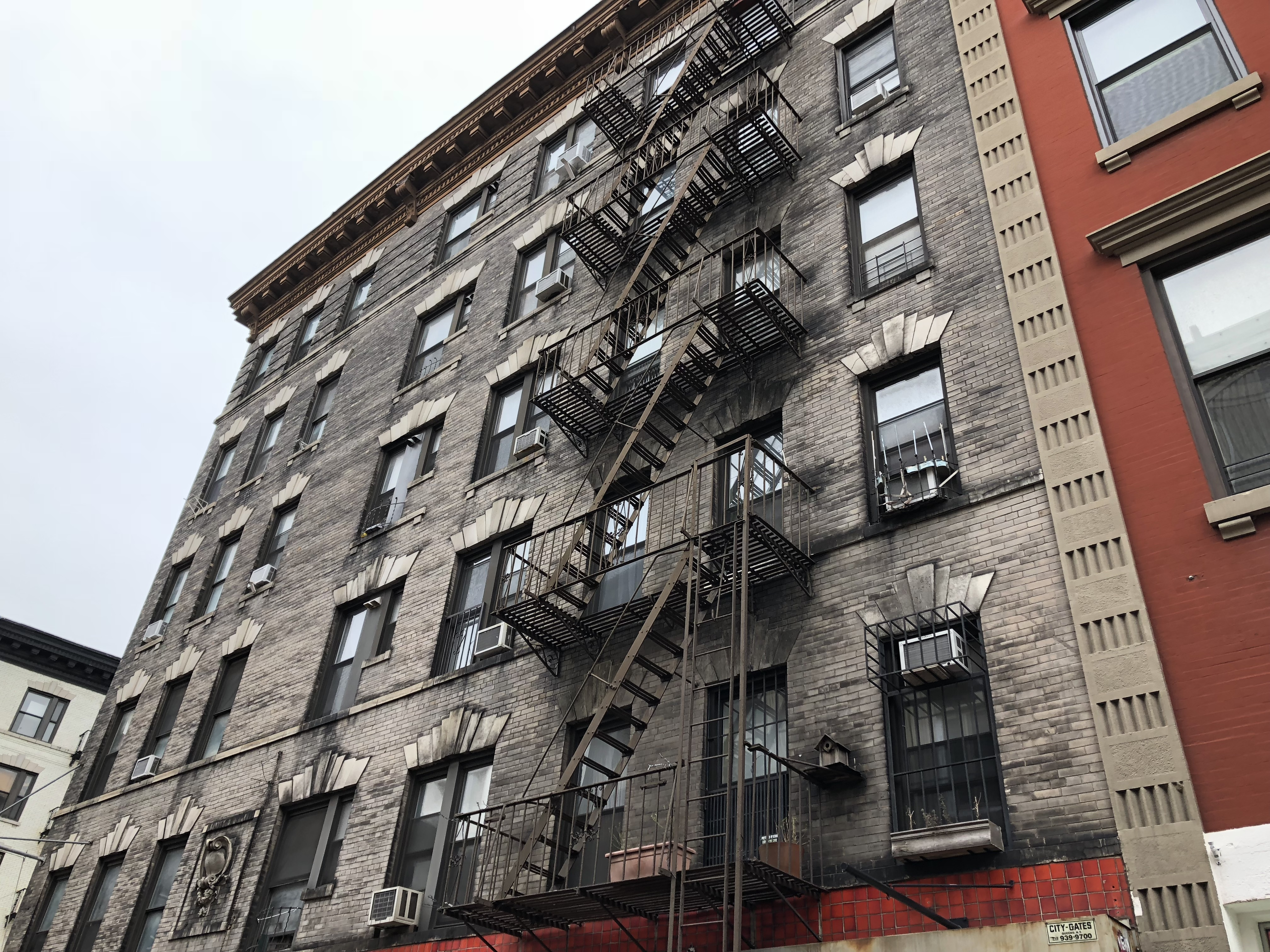 Nyc Fire Escapes Sullivan Engineering Llc | External Metal Fire Escape Stairs | Metal Railings | Stock Photo | Stair Railing | External Spiral Staircase | Fire Safety