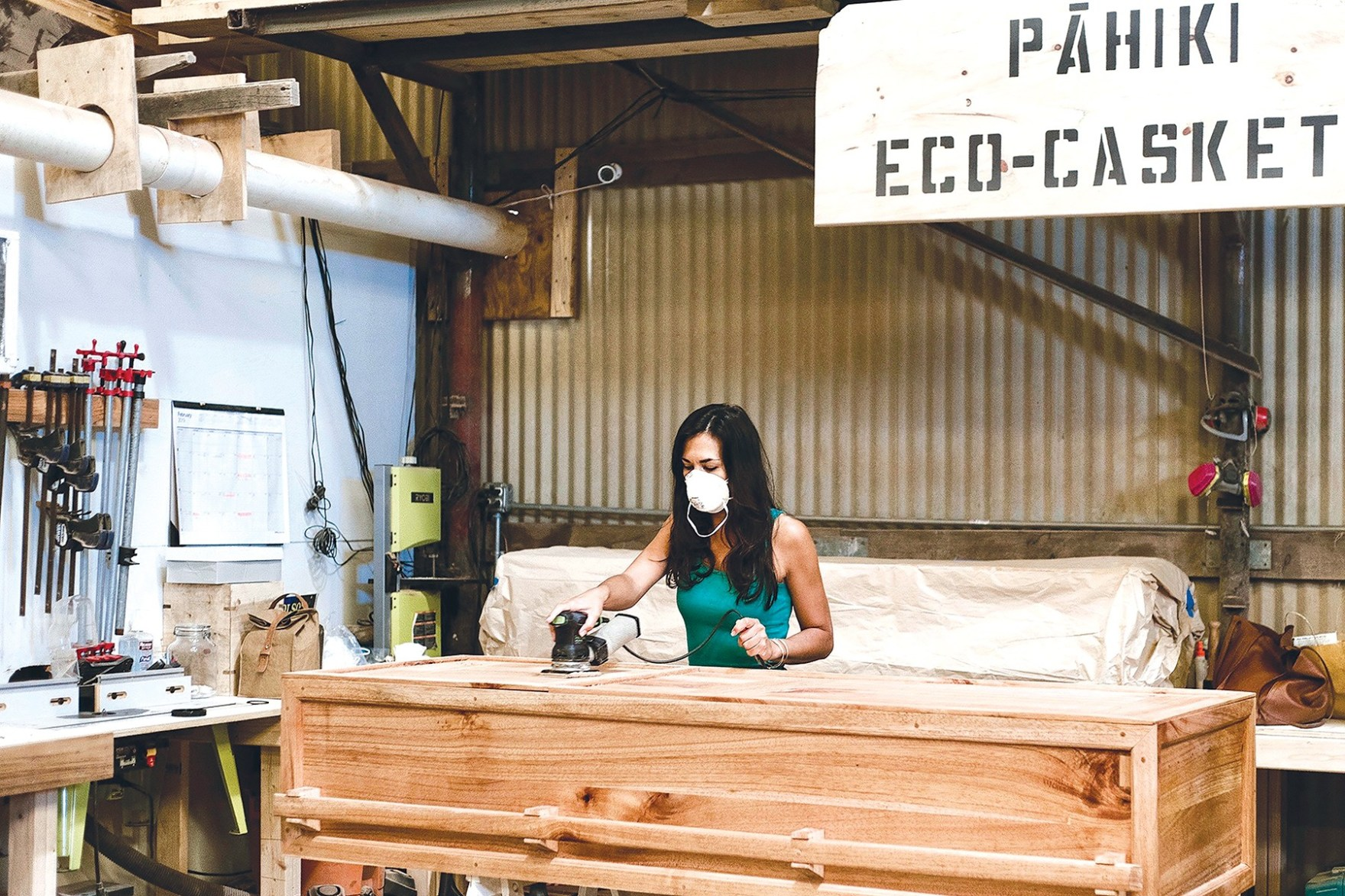 Cortney-Gusick-finish-sanding-Pāhiki's-100_-locally-reclaimed-biodegradable-and-invasive-Albizia-eco-casket