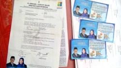 Surat pernyataan penerimaan kartu Wakatobi Bersinar yang ditandatangani oleh Bupati dan Wakil Bupati Wakatobi, Arhawi-Imiati Daud. (Foto: Amran Mustar Ode/SULTRAKINI.COM)