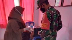 Proses penyuntikan vaksin di Puskesmas Sangia Wambulu, (Foto: Ist)
