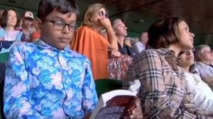 Indian boy chose to read a book while the epic match.