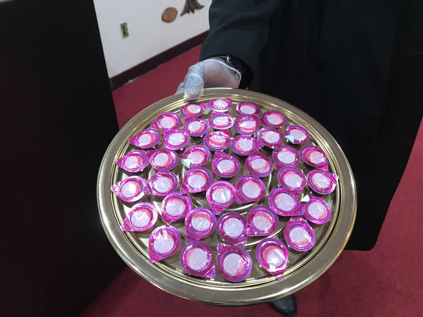 Communion wafers and wine was distribution prior to the service so as to minimize movement and interaction.