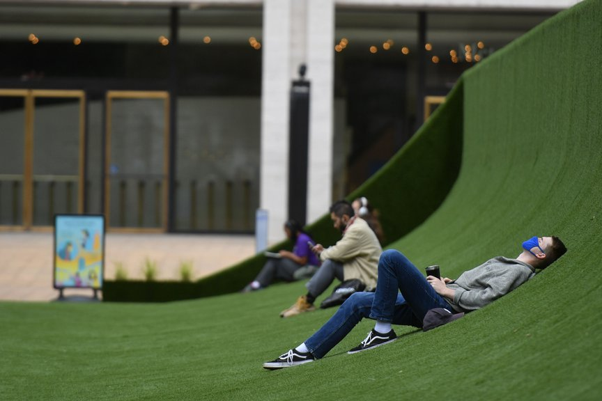 Photographs of the big green lawn across Lincoln Center's plaza