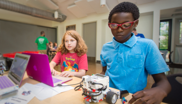 Two campers program a LEGO robot
