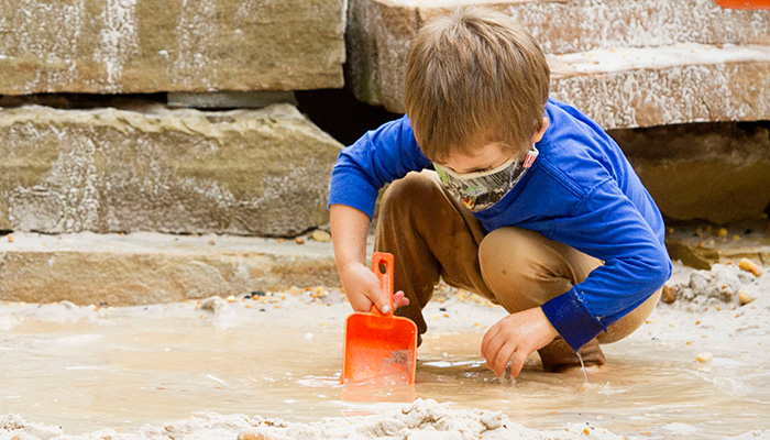 A kid digging at Earth Moves