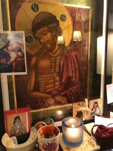 Image of author's desk with icon of Christ the Bridegroom, wearing a deep purple robe, crowned with thorns, hands bound, with a large gilded halo