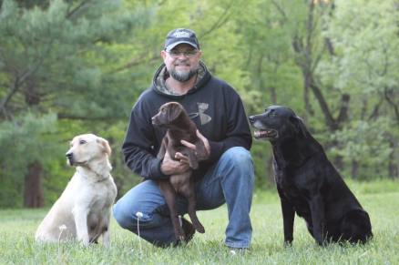 Chris with labs