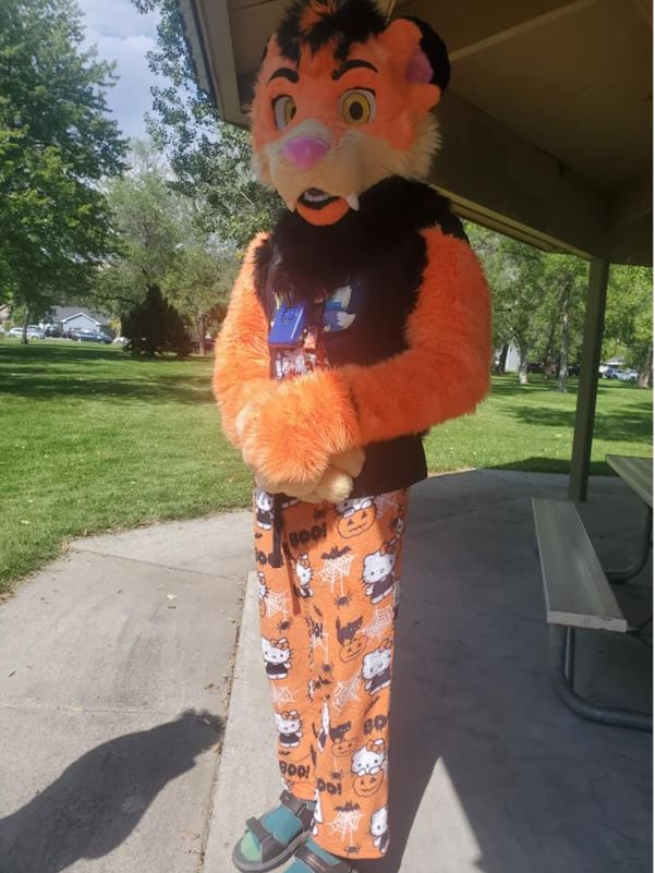 A person in a fursuit poses for a picture, being one of the few representations of the furry community during the Billings PRIDE Festival.