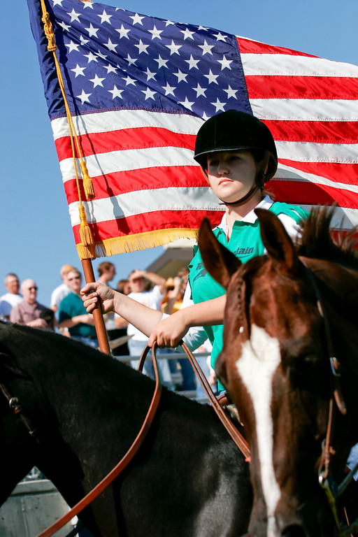 Rocky Mountain College equestrian student during the 2006 Homecoming game carrying the flag for the national anthem.