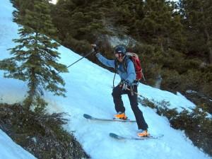 Pat sliding down snow between trees