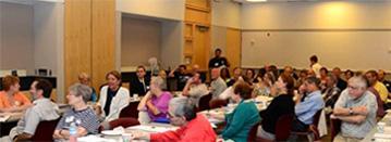 Members in large meeting room