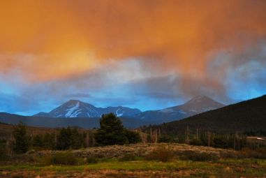 Spring thunderclouds drop low over Guyot and Baldy.